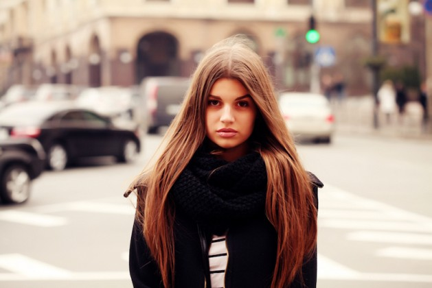 Portrait of beautiful girl outdoors. Young hipster woman in the city traffic learning to say no, self empowerment