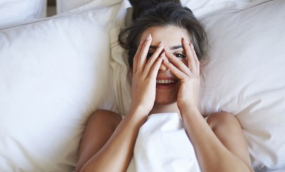 shy sleepy woman in bed morning person