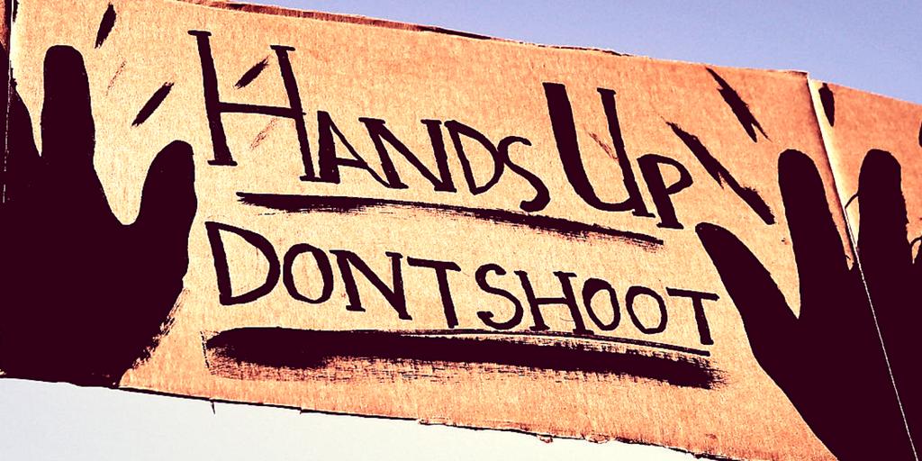 police brutality black lives matter hands up don't shoot sign protests