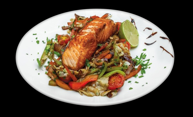 cooked salmon with vegetables on plate