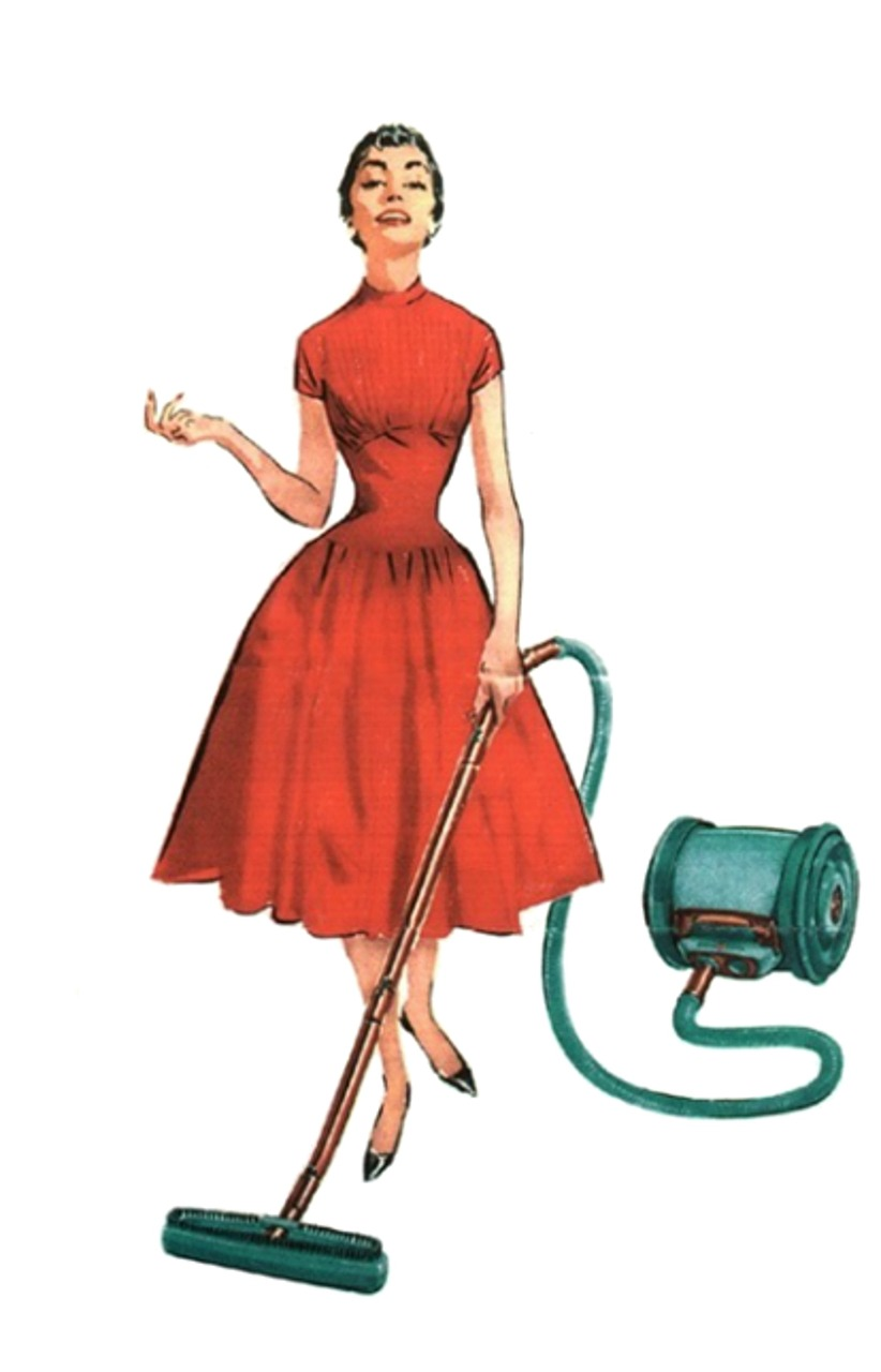 Woman in dress vacuuming