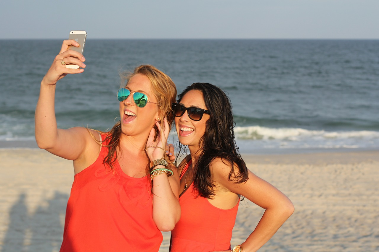 Two girls on the beach taking a selfie