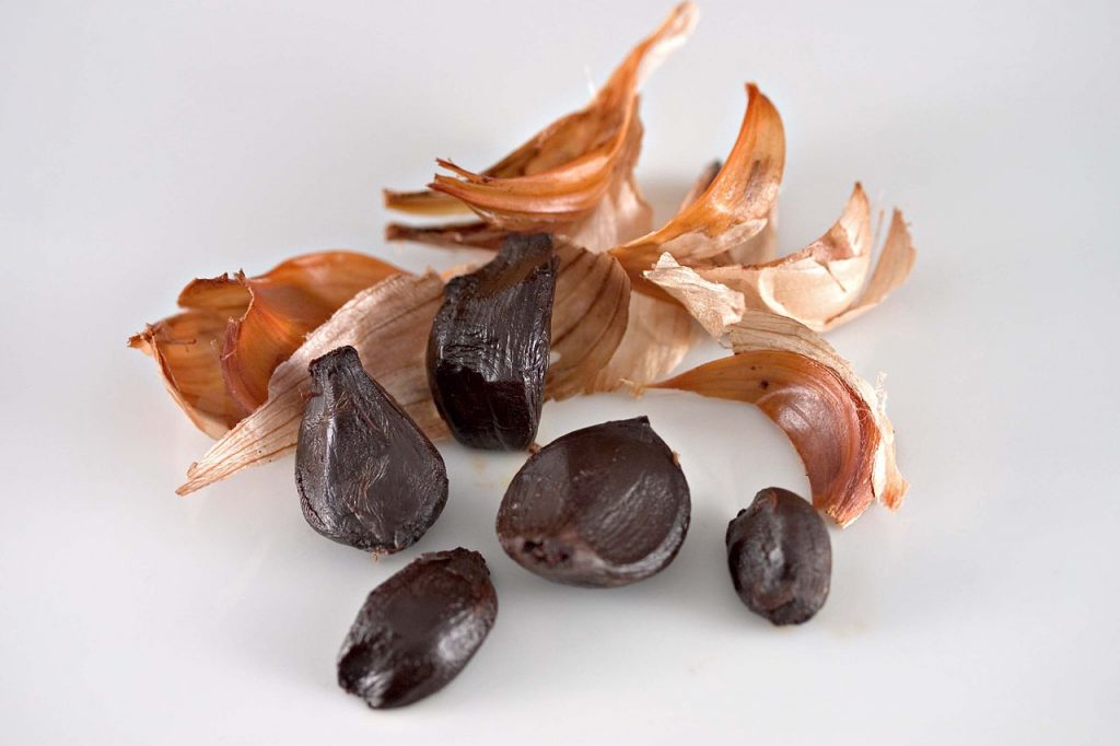 peeled black garlic cloves used to make black garlic aioli