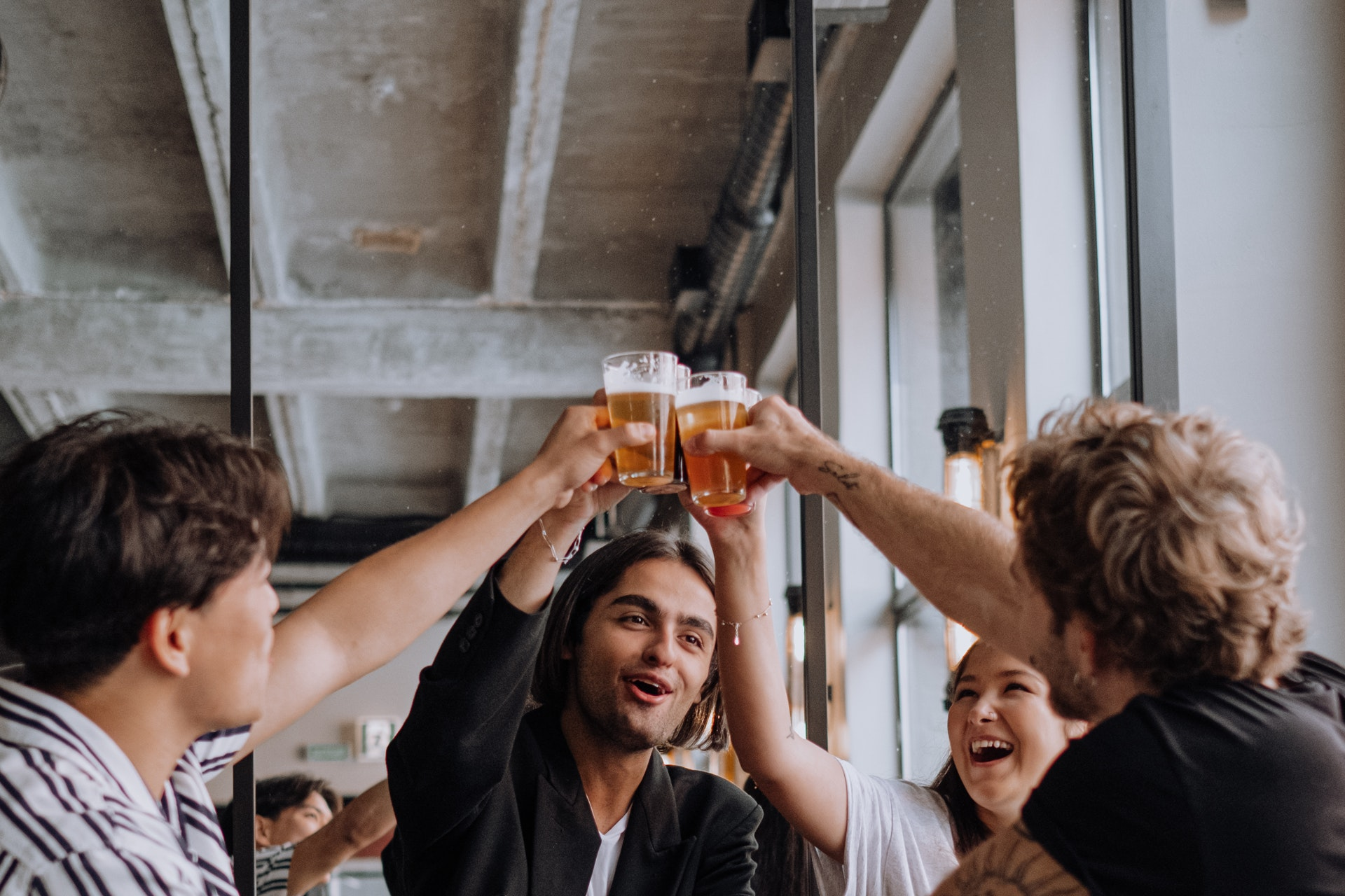 People toasting over beers and giving thanks